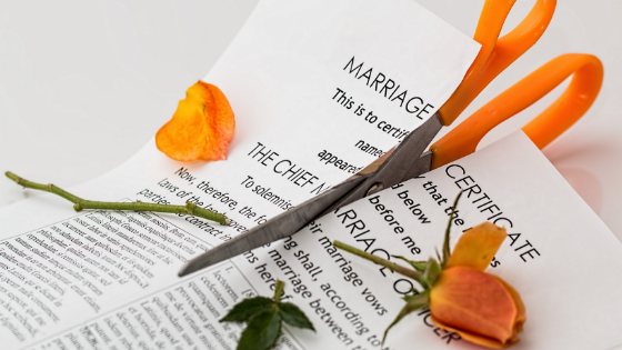 a marriage contract that is cut by a scissor