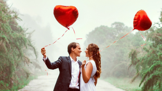 a couple with balloons
