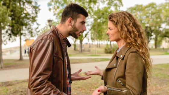 a girl talking to a boy