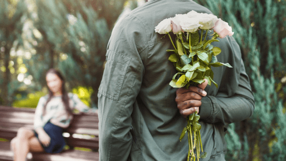 man bringing flowers to his russian date